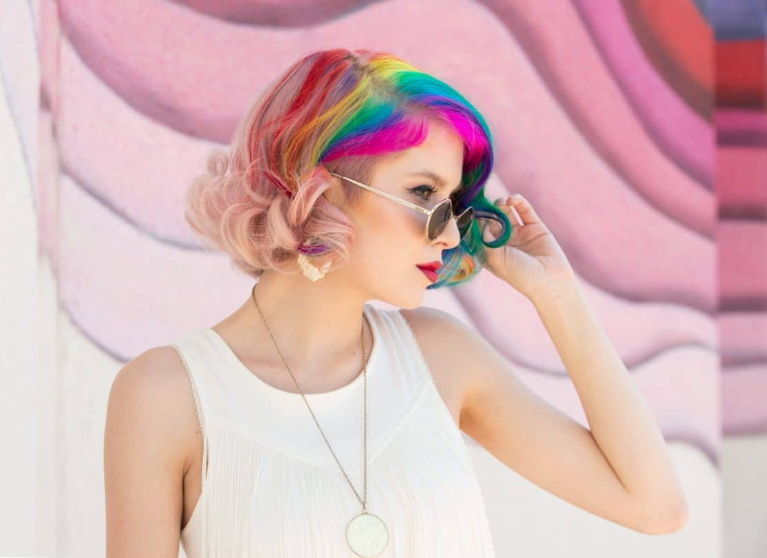 Using colorful backdrops is a creative way to make a professional portrait photography.